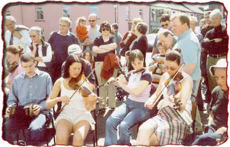 David Needham, Margaret McGovern, Sarah Jane Woods, Sorcha O'Grady playing in outdoor session